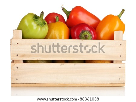 fresh paprica in wooden box isolated on white - stock photo