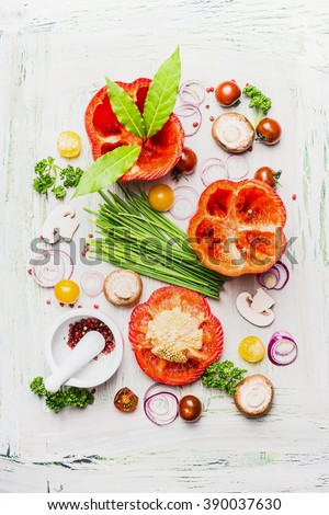 Fresh Paprika vegetables and ingredient  for cooking on white rustic background, top view. Healthy and clean eating concept. - stock photo