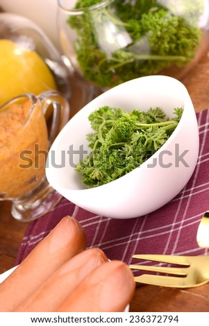 fresh parsley and tasty sausages - stock photo
