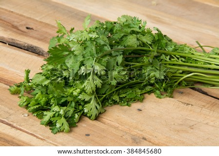 Fresh parsley on wood background, side view