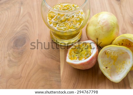 Fresh passion fruits and passion fruit juice on wood table