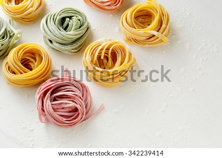 fresh pasta on wooden background, raw food - stock photo