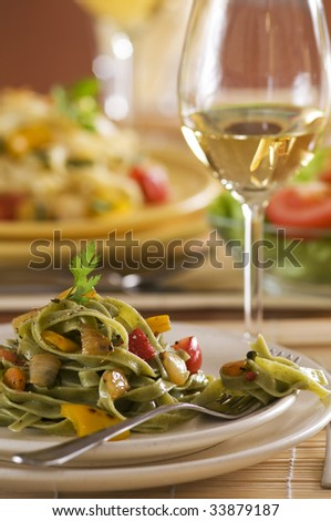 Fresh pasta salad with roasted vegetables close up - stock photo