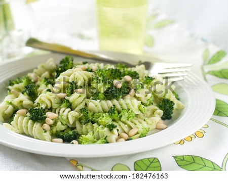 Fresh pasta with broccoli, pesto and pine nuts, selective focus