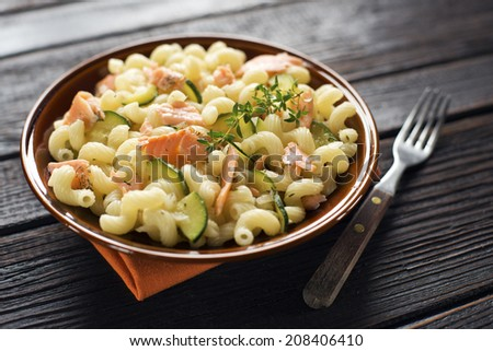 Fresh pasta with smoked salmon and vegetable - stock photo