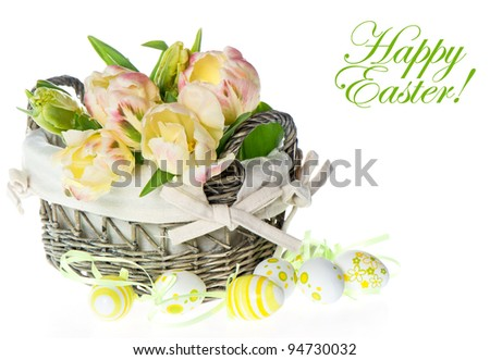 fresh pastel colored tulips in the basket with easter eggs decoration on white background. card concept