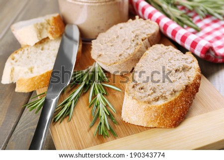 Fresh pate with bread on wooden table - stock photo