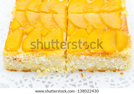 fresh peach cheese cake with coconut shavings - stock photo