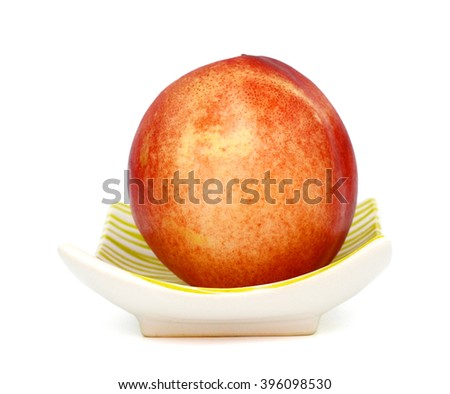 fresh peach on plate isolated on white  - stock photo