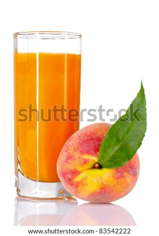 Fresh peaches and glass with juice isolated on white