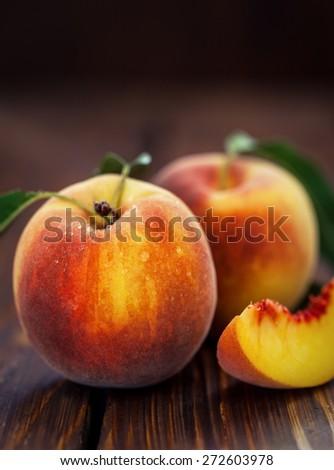 Fresh Peaches on Wooden Table - stock photo