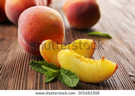 Fresh peaches on wooden table, closeup - stock photo