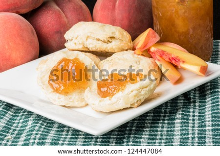 Fresh peaches with biscuits and peach jam - stock photo