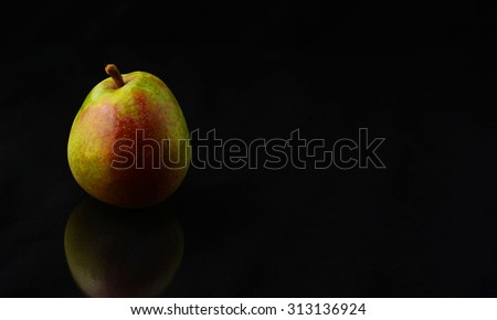 Fresh Pear isolated over a black background - stock photo