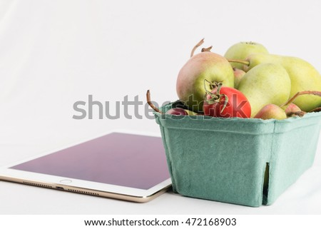 Fresh pears in a carton box and tablet pc