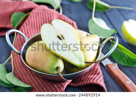 fresh pears in bowl and on a table - stock photo