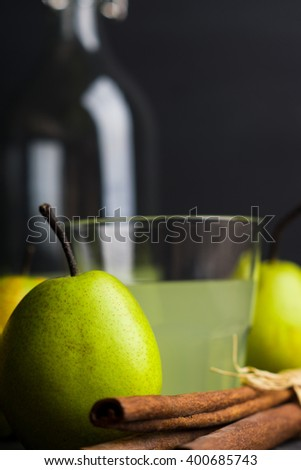Fresh pears on a rustic wooden background. Shallow depth of field.
