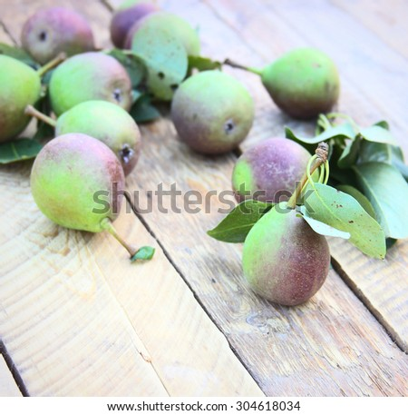 Fresh pears on a wooden background