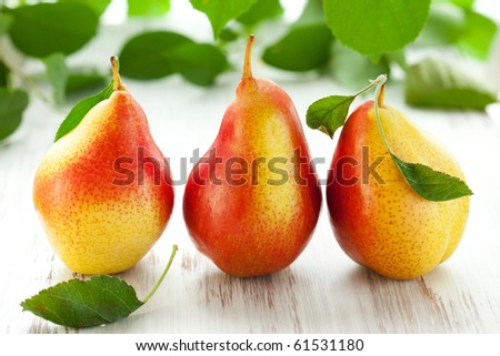 fresh pears with leaves  on the white wooden  table
