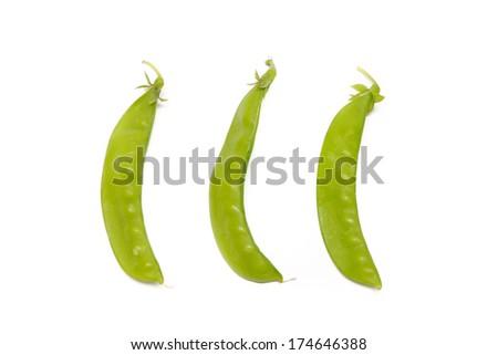 Fresh peas isolated on white background - stock photo