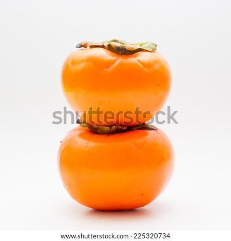 Fresh Persimmon in white background.