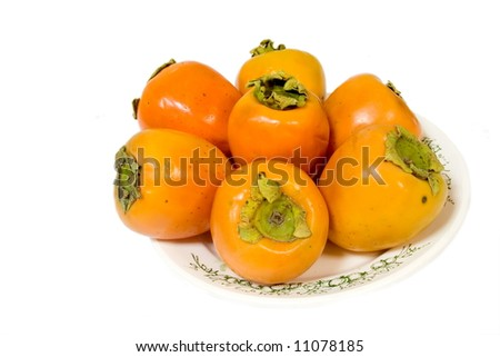 fresh persimmons isolated on white - stock photo