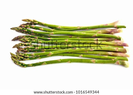 Fresh picked asparagus on white background in horizontal format with room for text
