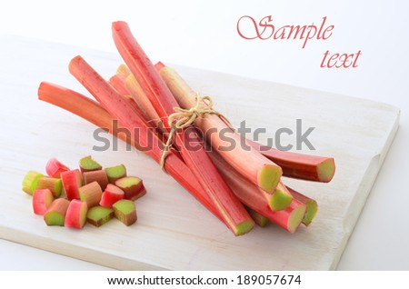 Fresh picked rhubarb in horizontal format with room for your text - stock photo