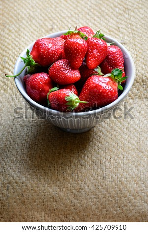 Fresh Picked Ripe Strawberries in a Bowl. Organic fruit filled with vitamin ready for delicious dessert. / Fresh Strawberries in a bowl / Fresh Strawberries - stock photo