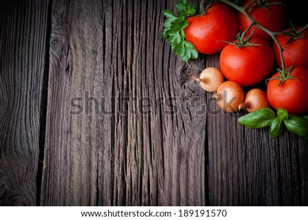 Fresh picked tomatoes and ketchup ingredients composition. Vegetables photography taken on rustic old table. - stock photo