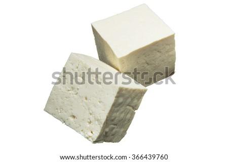 Fresh pieces of tofu on white background - stock photo
