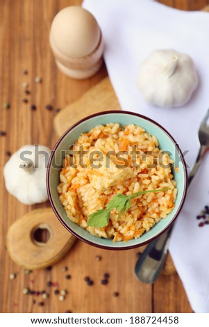 fresh pilau in a bowl with a garlic, in a studio