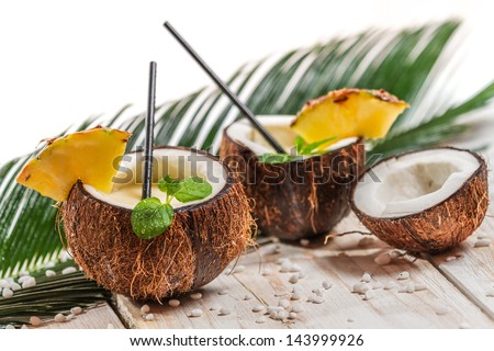 Fresh pinacolada drink served in a coconut