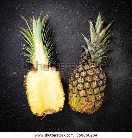 Fresh pineapple on dark background - stock photo