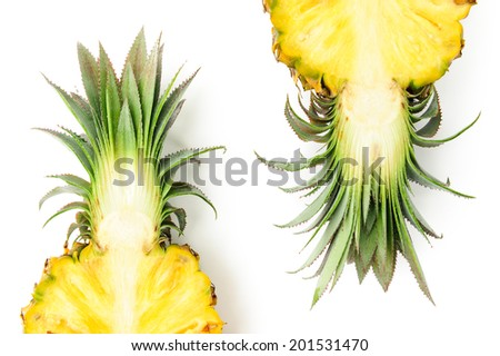 fresh  pineapple,yellow flesh with green leaves - stock photo