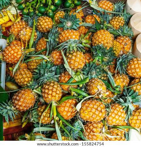 Fresh pineapples in fresh fruit market - stock photo