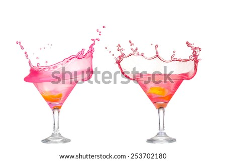 Fresh pink cocktail, lemon isolated on white background splash - stock photo