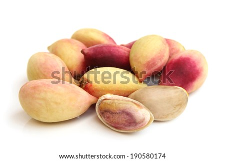 Fresh pistachios on white background - stock photo