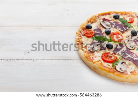 Fresh Pizza In A Rustic Italian Style With Jerky Olives Mushrooms And Three Kinds Of Cheese