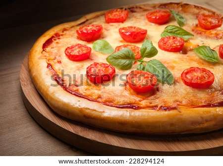 Fresh pizza on wood  - stock photo