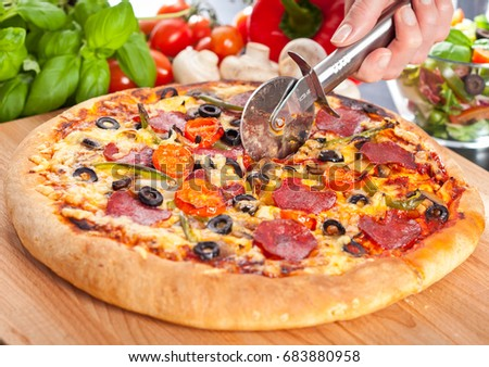 Fresh pizza with pepperoni and vegetables
