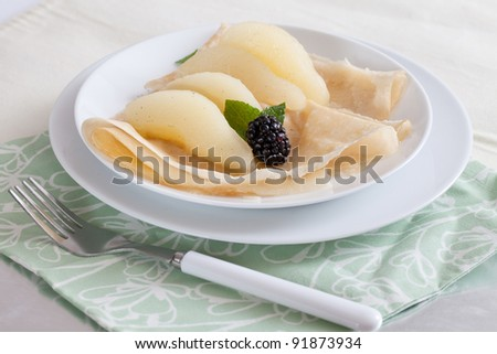 Fresh Plate of Pears in A Light Syrup with Blackberries and mint, infused with Vanilla Bean - stock photo