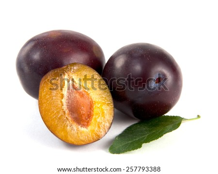 Fresh plums isolated on white - stock photo