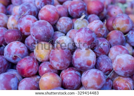 Fresh plums on market. Plum healthy nutrition concept