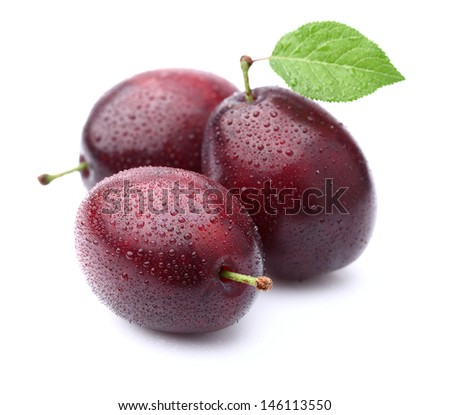 Fresh plums with leaf - stock photo