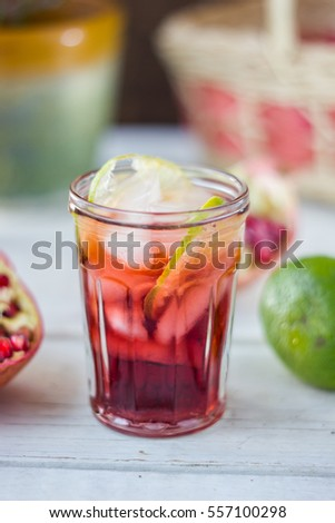 Fresh pomegranate lemonade with ice and lime