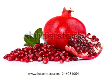 Fresh pomegranate with seeds in the front - stock photo