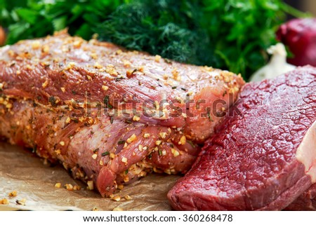 Fresh pork carbonade, beef steak meat marinated and prepared for roast with garlic, herbs. - stock photo