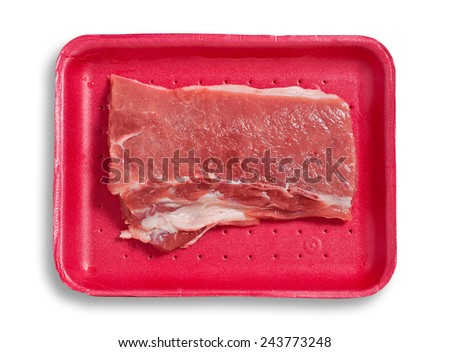 Fresh pork meat on a plastic tray. Isolated, white background, clipping path excludes the shadow.  - stock photo