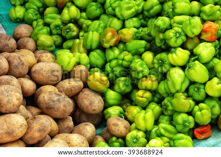 Fresh potato and green pepper at a market